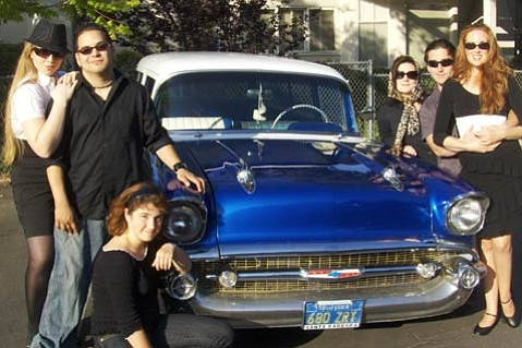 The cast of <em>Tony & the Soprano</em> posing with one of Tony's classic cars.