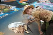 Joy Davis looks up and smiles, sharing the spirit of I Madonnari will all of those who pass by.