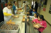 The lunch line at Harding School this Friday offers in-house, hand-made pizza, organic fruit and vegetables from Farmers Market, and trail mix for dessert all served on compost-able plates and utensils.