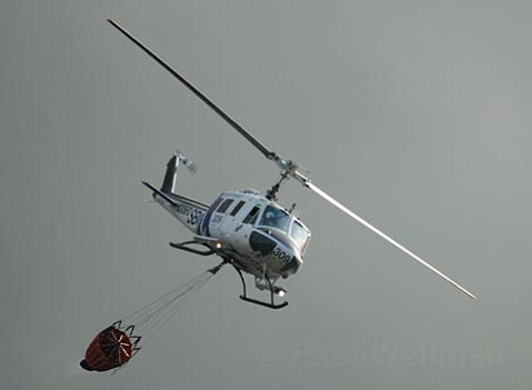 <strong>Dueling departments:</strong>  The Santa Barbara County Fire and Sheriff's departments are in a disagreement on how to handle the county's four-chopper aviation unit. Here, one of Fire's choppers drops water on the Jesusita.