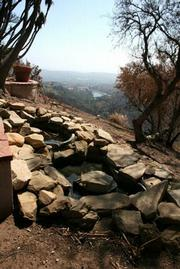 The Keltners' koi pond after the fire. Laurel Reservoir is in the background.