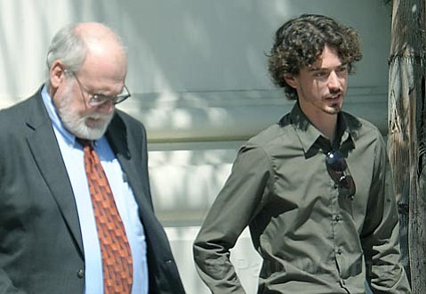 Graham Pressley (right) leaving the courthouse Friday afternoon June 6, 2009