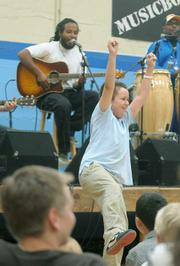 "El Montecito 3rd grader Sam Edwards takes flight shows off his moves during a song called ""Ziggy says"""