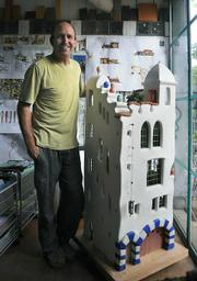Shelton with his model of the one-room-big and four-story-tall Ablitt House.