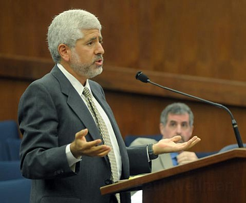 <strong>Continuing Confusion:</strong>  Stanley Lampwert, attorney for hopeful Naples conqueror Matt Osgood, pleads his case at the Board of Supes this week. The Board ultimately voted to further delay the permitting process for the project.