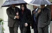 Michael Jackson leaves the Santa Maria Courthouse on a rainy day in March, 2005