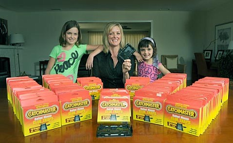 After getting Gelson's Market to stop carrying glue/mouse traps, Renee Papadopoulos, pictured with daughters Maya (left) and Elia (right), negotiated the purchase of the remaining 123 traps in stock.