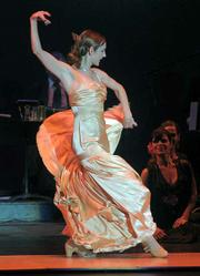 Lead dancer Celina Zambon delights audience members during Saturday's <em>Flamenco Loves Tango</em> performance at the Lobero.