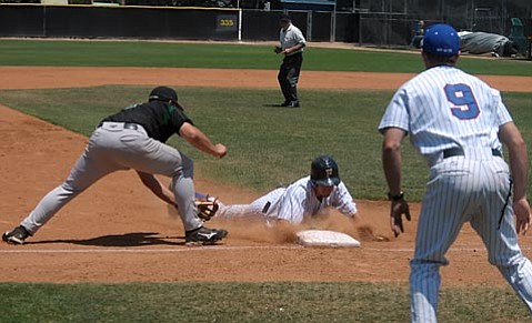Shortstop Drew Maggi is safe after a headfirst slide into third in his first game as an S.B. Forester.