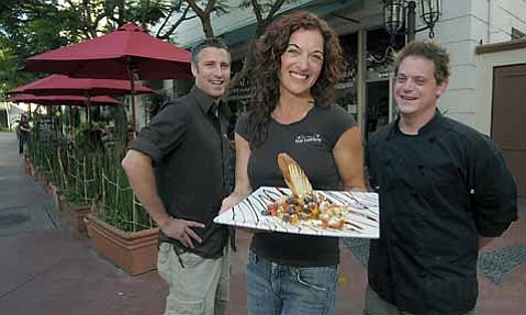 From left: Co-owners Darin Fiechter and Sierra Falso with Chef Daniel Bohl show off one of Live Culture's fabulous dishes in front of the Paseo Nuevo coffee shop/wine bar/restaurant/music venue.