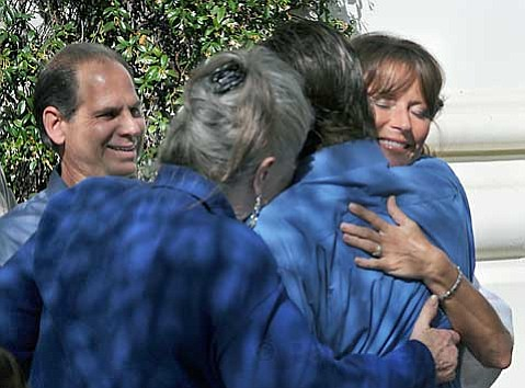 Jeff, Susan, and Ben Markowitz share a hug outside the Santa Barbara courthouse where Jesse James Hollywood was convicted of murder and kidnapping Wednesday afternoon.