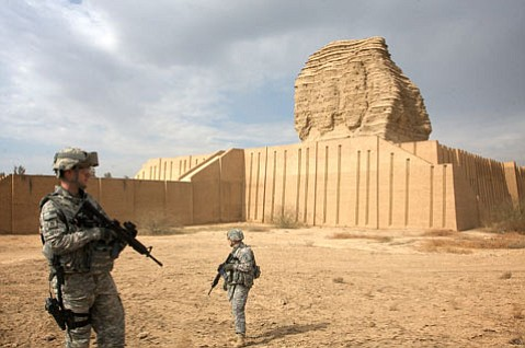 While Captain Calloway hashes out the details of a tourism program with Iraqi officials, Sergeant Ward (left) and Command Sergeant Major Stephen Johnson (right) stand guard at the Aqar Quf ziggurat, a 5,000-year-old relic of the Babylonian Empire