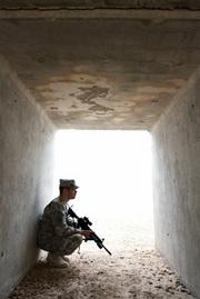 A trusted enlisted adviser to 425th Civil Affairs Battalion Headquarters Company commander Captain Cole Calloway, First Sergeant George Guerra-an engineer from Oxnard-rests inside a blast shelter at Camp Liberty.