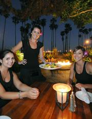 FisHouse servers (L to R) Ronni, Taler, and Sara, on the patio that overlooks the beach