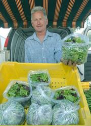 Tom Shepherd holds a bag of his famous salad mix