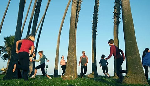 Choreographer Monica Robles Lopez rehearses with dancers at Cabrillo Boulevard in preparation for a dance installation at the Santa Barbara Botanic Garden.