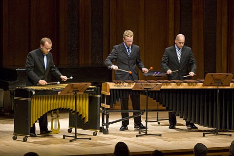 Kevin Kosnik (pictured center in a previous performance) was the soloist on Bob Becker's Girlfriends Medley, a ragtime suite arranged for xylophone, marimbas, and drum set.