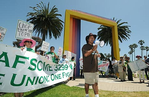 AFSCME local 3299 custodial and food service workers protest pay cuts outside the Double Tree Resort where UC President Mark Yudof came to speak at an award luncheon on Aug. 6, 2009