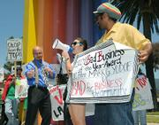 """Outside the Double Tree Resort budget cut protesters hold a mock award ceremony giving Mark Yudof """"the 2009 Bad Business of the Year award"""""""
