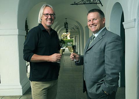 Doug Margerum and Mitchell Sjerven toast to the plans of re-opening the Wine Cask