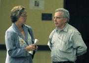 Iya Falcone talks with POA chief Sgt. Charles McChesney after the mayoral forum on 8/14/09