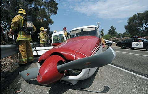 A plane lies on the side of the 101 freeway after making an emergency landing.