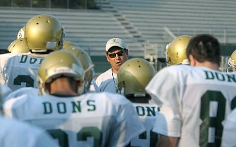 <strong>Touchdown:</strong>  S.B. High School head coach Jaime Melgoza works closely with his Dons during practice.