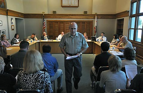 <strong>OUTSIDE THE BOX:</strong>  Stan Freedman (pictured addressing the School Board this week) had never met pink-slipped Santa Ynez High School teacher Diane Siegal, but the retired law enforcement officer has been working to raise money to reinstate her full-time job and that of other Santa Ynez teachers impacted by the current state budget crisis.
