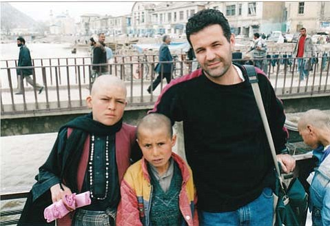 Khaled Hosseini with two Afghan chilldren.