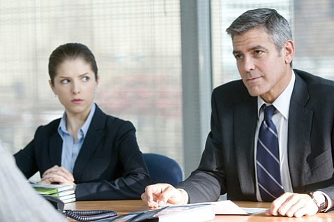 The arrival of Natalie Keener (Anna Kendrick) complicates Ryan Bingham's (George Clooney)  work life in <em>Up in the Air</em>.