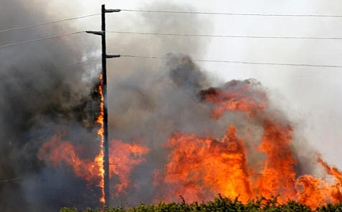 The VAFB Fire burns a power pole on the base. Power was knocked out throughout the base. 9/30/09