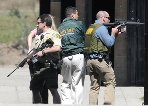 Deputies searching San Marcos High hallways, assault rifles drawn.