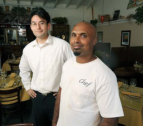 Spiritland Bistro general manager Ken Morino (left) and head chef Kamal Debegemage.