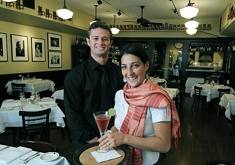 Tre Lune bartender Patrick Rathbun (left) whipped up the cosmo that manager Elisa Zampiga is getting ready to serve.