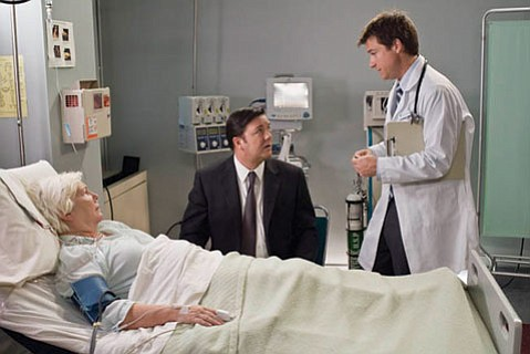 <em>The Invention of Lying</em> takes place in a world where everyone tells the truth, until Ricky Gervais (center) comforts his dying mother with a story about the afterlife.