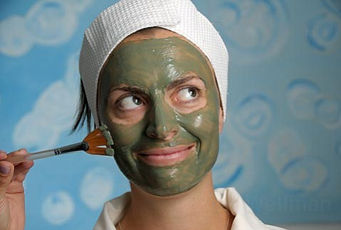 Natalie Rowe, co-owner of Float Luxury Spa, tries out one of her own products-a green tea mask.