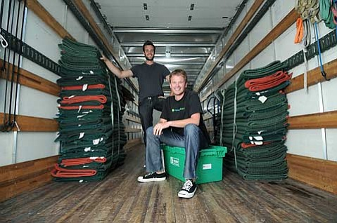 Movegreen's co-owners Patrick Wilkinson (left) and Erik Haney (foreground) founded the environmentally friendly moving company in December 2007.