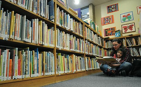 Cressida Silvers and 2 year-old daughter Noelle (Carrera) make a weekly habit of visiting the Goleta Library.