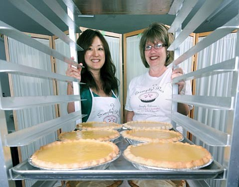 <strong>The pies have it:</strong>  Co-owners Hana Miller (left) and Nancy Blau provide fresh, seasonal offerings through Simply Pies, which recently added retail hours on Saturdays.