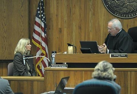 Judge George C. Eskin clarifies testimony procedure to Christen Brown