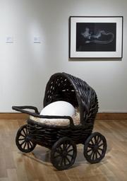 Liz Craft, <em>Baby Carriage</em>, 2008. Bronze, porcelain, raffia. The Fowler Collection.