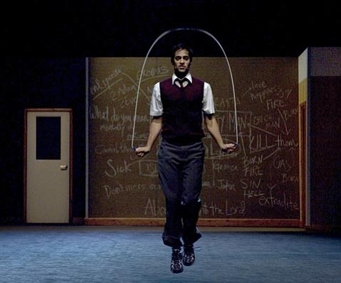 Performer Ankur Bahl jumps rope while describing a homophobic attack.