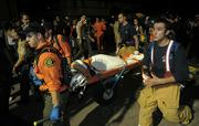 First responders rush a medical victim through the crowds in I.V. on halloween 2008