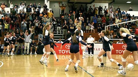 The Dos Pueblos Chargers celebrate their victory in the CIF Southern Section Division 1A girls' volleyball final.