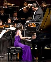 Pianist Yuja Wang performs Rachmaninoff while maestro Long Yu conducts members of the Shanghai Symphony Orchestra at the Granada Theatre.