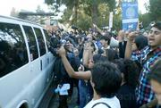 Students and workers storm the first van attempting transport Regent board members to their cars from the meeting place. The vans ultimately were unable to move for many hours, due to protestor-blocked streets.