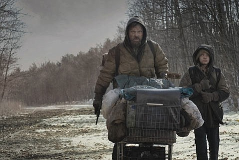 A father and son journey forward in a post-apocalypse world in the film adaptation of Cormac McCarthy's <em>The Road</em>.