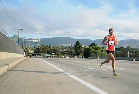 Carlos Handler crosses the Turnpike overpass in the lead which he held on to until the finish
