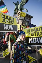 One of many faces in the crowd on Saturday. Protesters came from all over the world to let conference delegates know that climate change, to them, is a social justice issue.