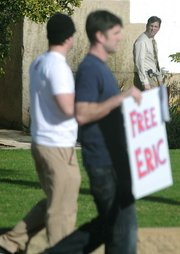 Dec. 31, 2009 Judge Brian Hill, (far right) who oversaw the 2007-08 Frimpong case, happens by as a small group marches in support of Eric Frimpong who they believe was wrongly convicted of rape.
